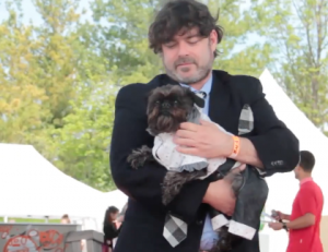 Adorable dog in formal wear at ruff stitched fashion show woofstock 2017