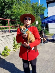 The adorable Harlow with a Canadian Mountie. Photo courtesy of @the_harlow